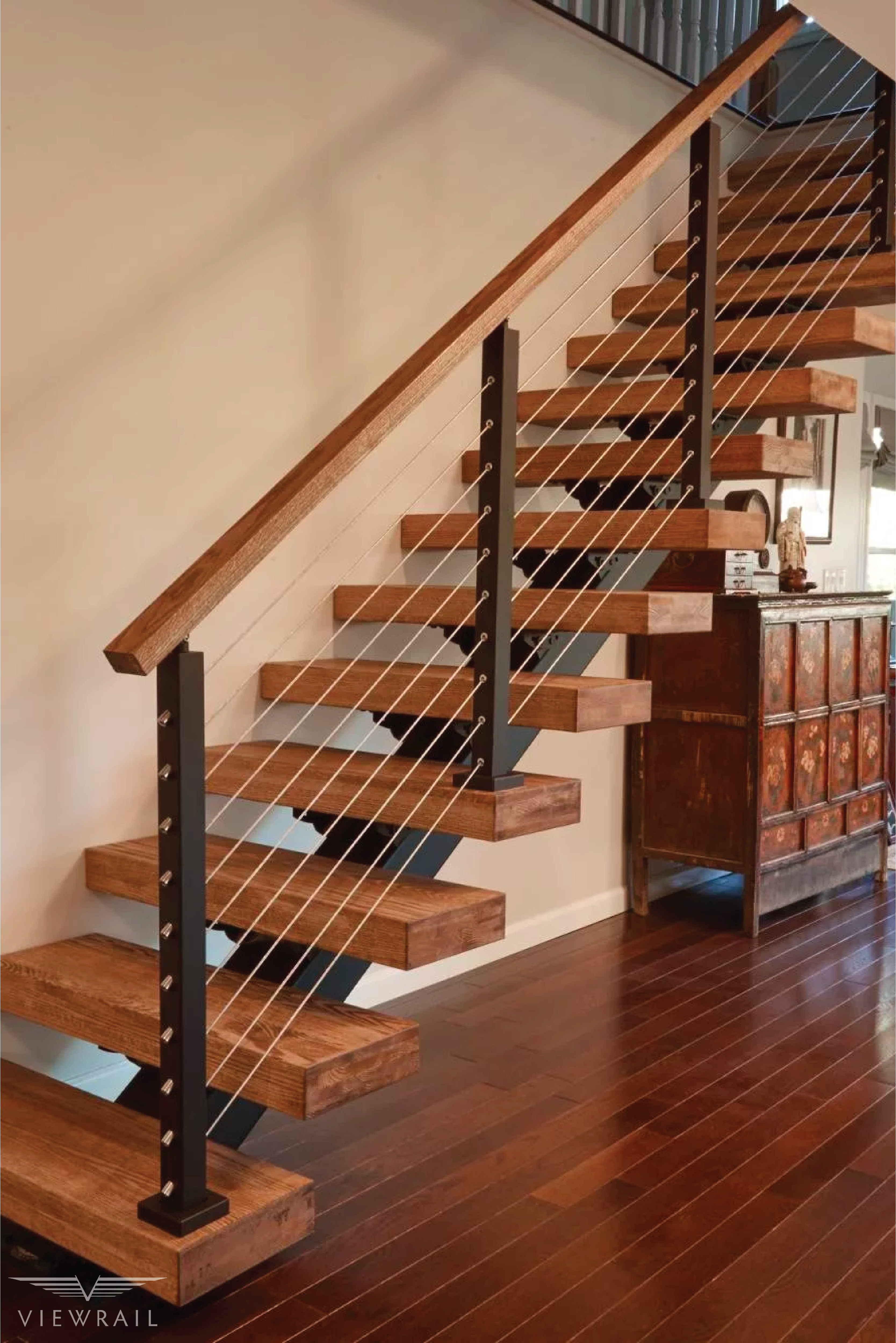 Floating Stair DIY Install #floatingstairs This New York FLIGHT features a custom stringer, quarter-sawn clear-coated white oak treads, and black aluminum cable railing posts. The homeowner was able to install the project by himself with the help of a friend, proving once again that with FLIGHT floating stairs, quality and DIY aren't mutually exclusive. #design #interiordesign #DIY #renovation #Viewrail #ViewrailFLIGHT #FloatingStairs #FloatingStaircase #stairs #staircase #architecture #cabler