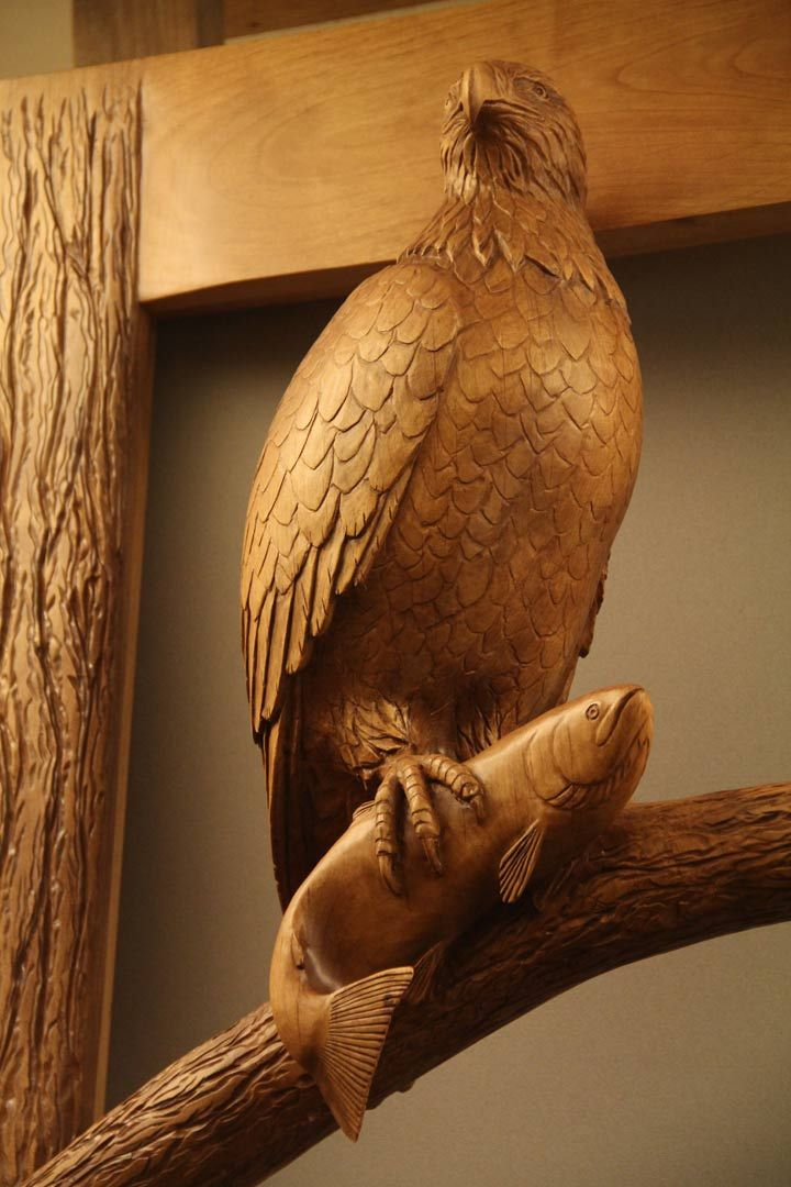 Eagle sculpture holding salmon carved wood door doors