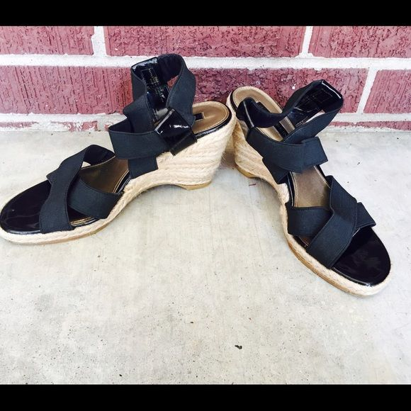 """Bandolino Black elastic strap wedge heel. Adorable black elastic strap and patent leather side sandal with braided rope wedge heel. 3"""" heel ht. In excellent used condition. Bandolino Shoes Wedges"""