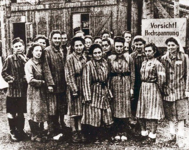 Women's concentration camp victims smile before