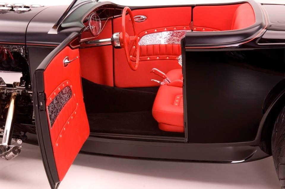 amazing Roadster built by the one and only Kindig-it Design. red black and sheetmetal door panels