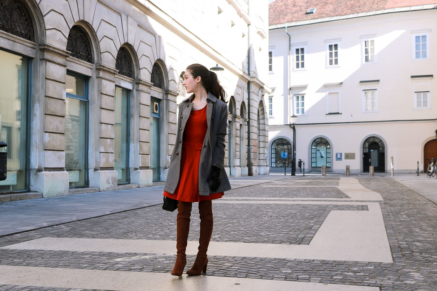 Fashion blogger Veronika Lipar of Brunette From Wall Street sharing her red dress outfit