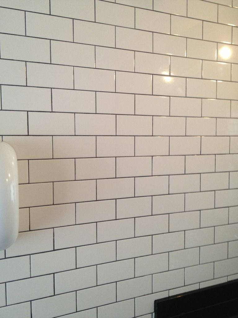 White Subway Tile With Dark Gray Grout Bathroom Gut