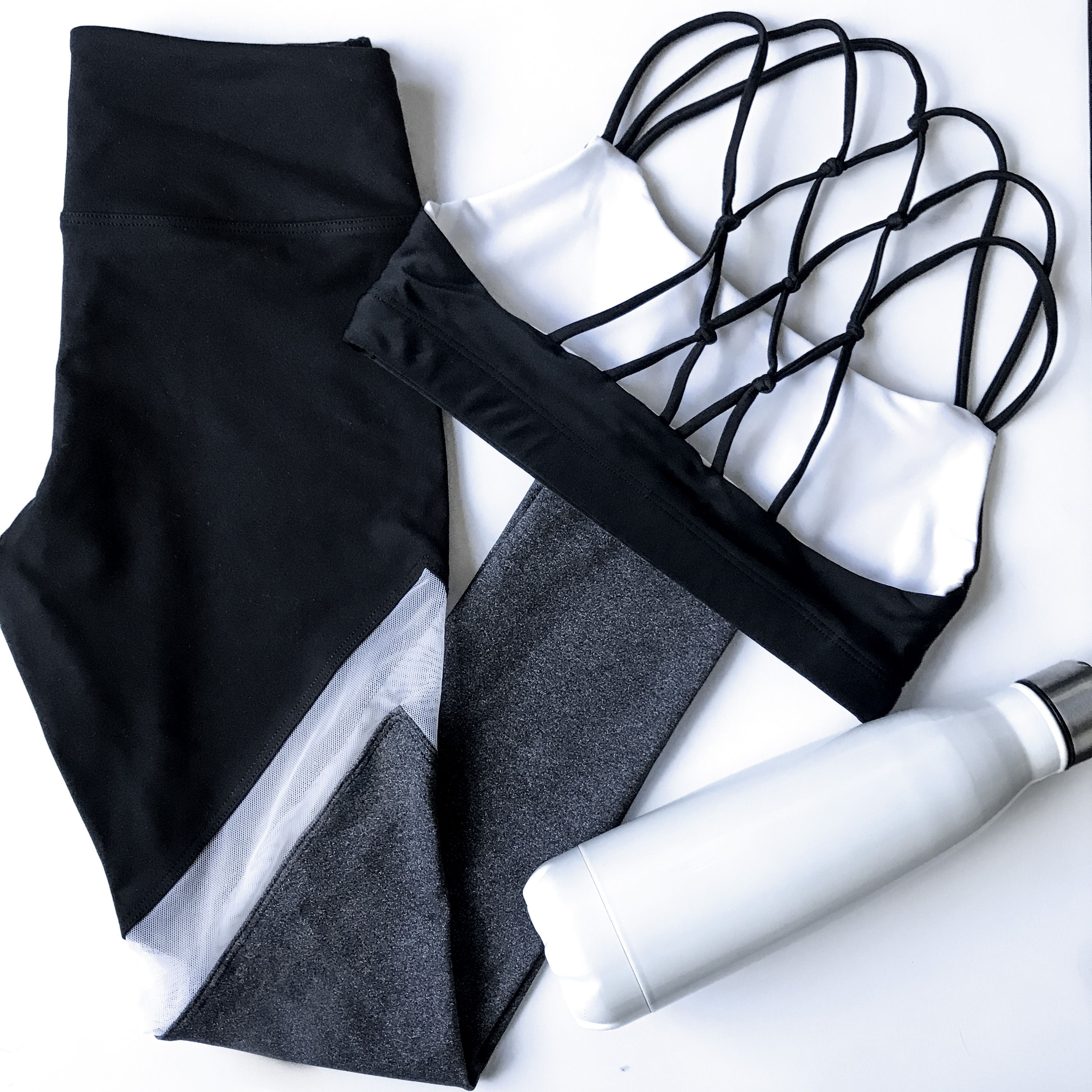 57217a9a1d Reversible black and white sports bra with strappy back detail. Matching  black and grey leggings
