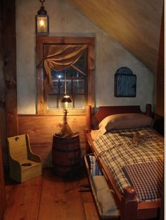 A little too primitive but love the window under the eaves, and the wide pine boards, and the bed <3
