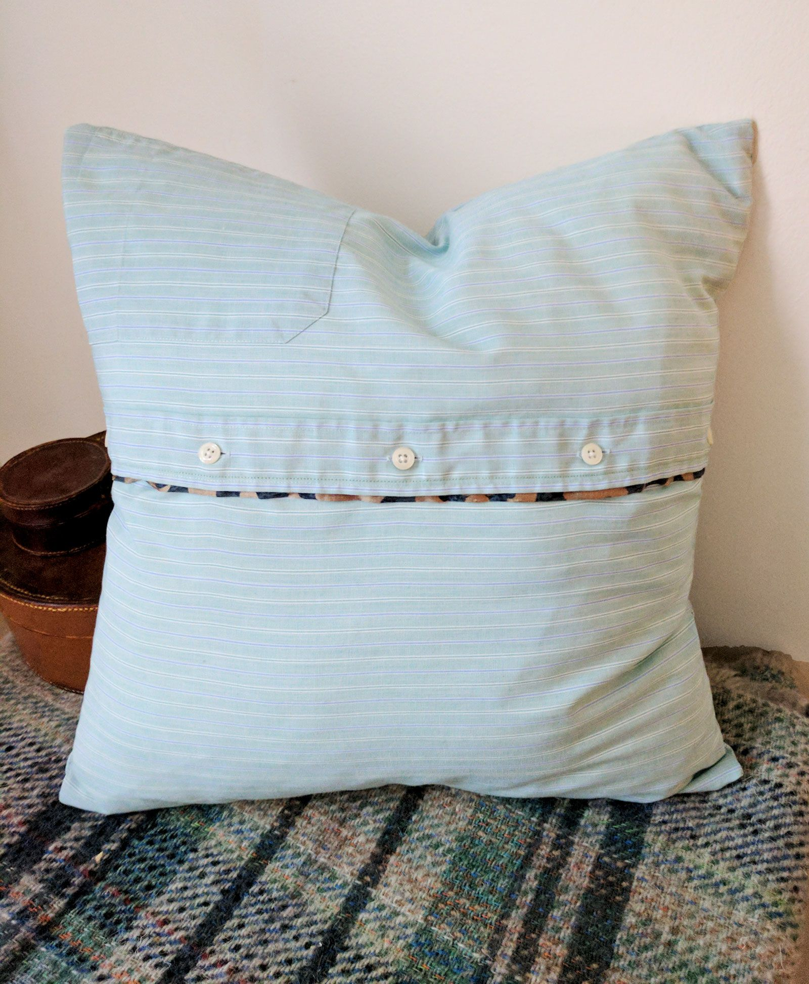 Green and blue striped cushion cover with navy silk tie trim