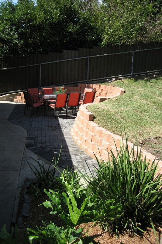Lower area and fire pit combo!!!!! LOVE   Sloped backyard ...