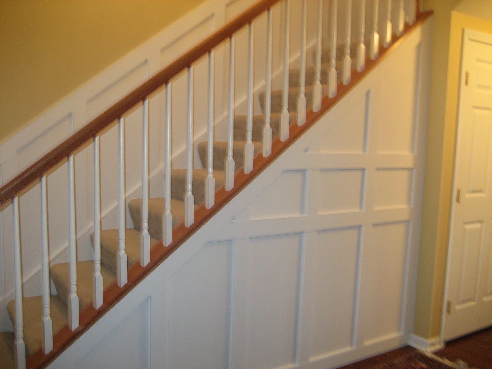 Foyer Trim Ideas : Wainscoting to cover the entire living room under stairs
