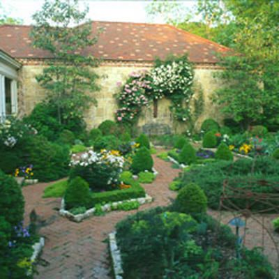 Potager, walled with brick paths. Nice formal style.