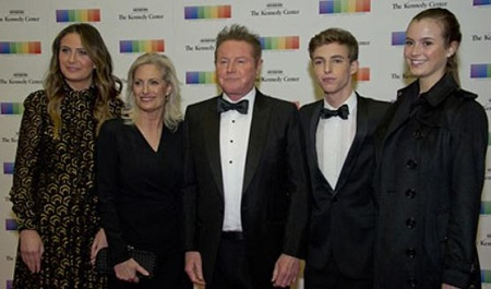 Sharon Summerall, along with her spouse and three
