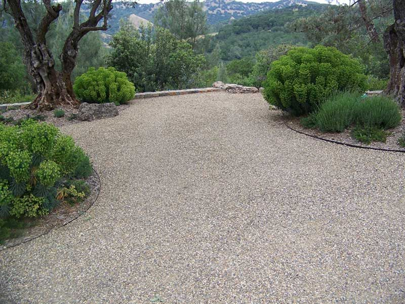 Chip And Seal Asphalt For The Carport And Behind The Bus Barn Front Garden Landscape Modern Garden Landscaping Driveway Landscaping