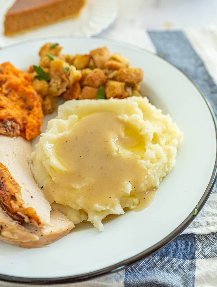 You'll be amazed by how easy this gravy is to make! #turkeygravyfromdrippingseasy This simple and flavorful homemade gravy comes together quickly using the leftover drippings from a roast turkey or roast turkey breast! You can simply whip this up in a few minutes before you serve a delicious holiday feast to family and friends with the use of a few pantry staple ingredients and the drippings from turkey! #gravy #turkeygravy #thanksgiving #thanksgivingrecipes #homemadegravy #gravyrecipe #holidayr #turkeygravyfromdrippingseasy