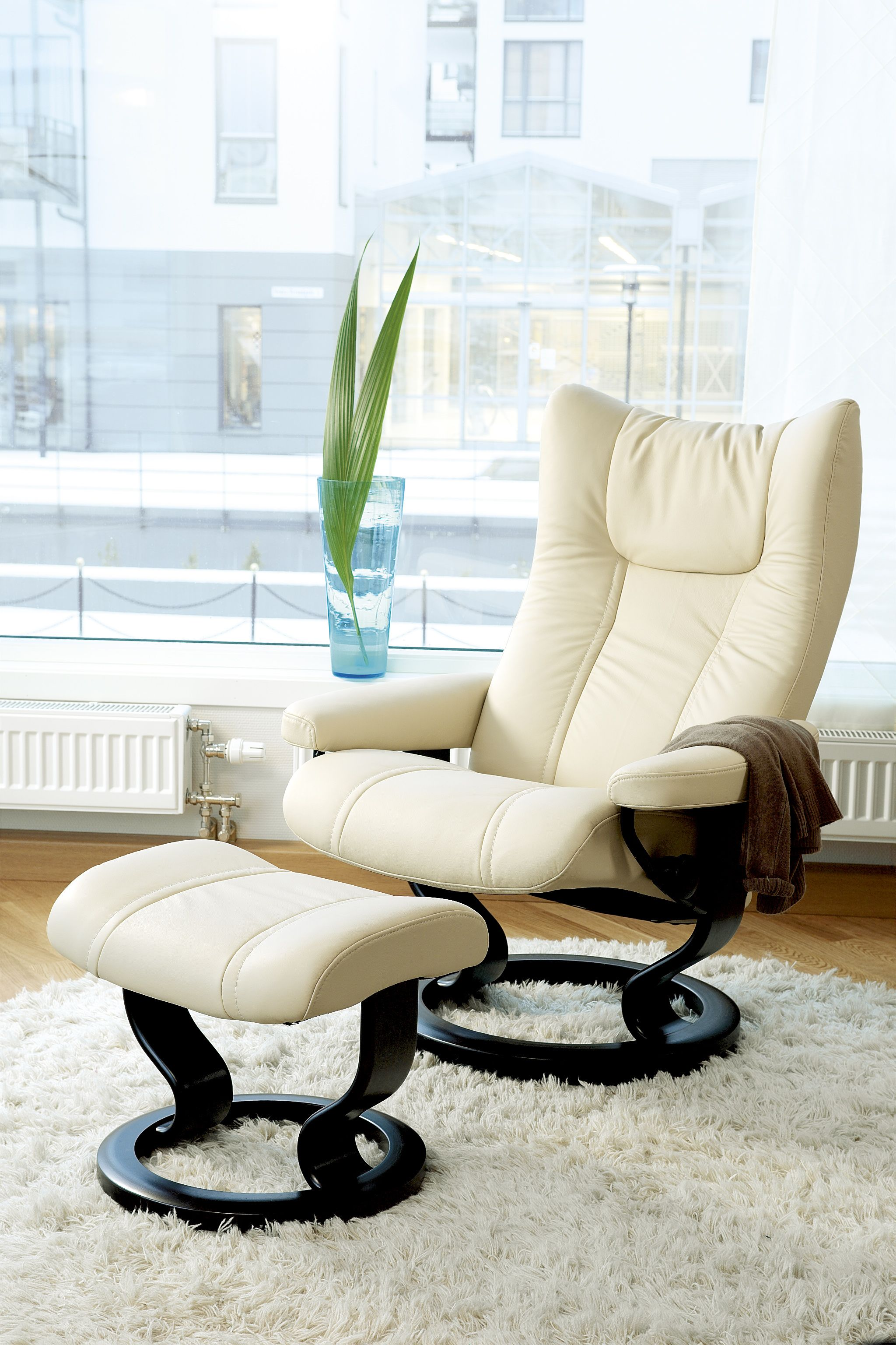 A Stylish Cream Recliner And Ottoman Perfect For The Modern