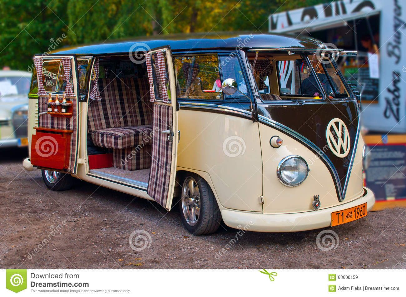 old and beautifully renovated vw t1 kombi van from 1960 with side doors wide open parked at a. Black Bedroom Furniture Sets. Home Design Ideas