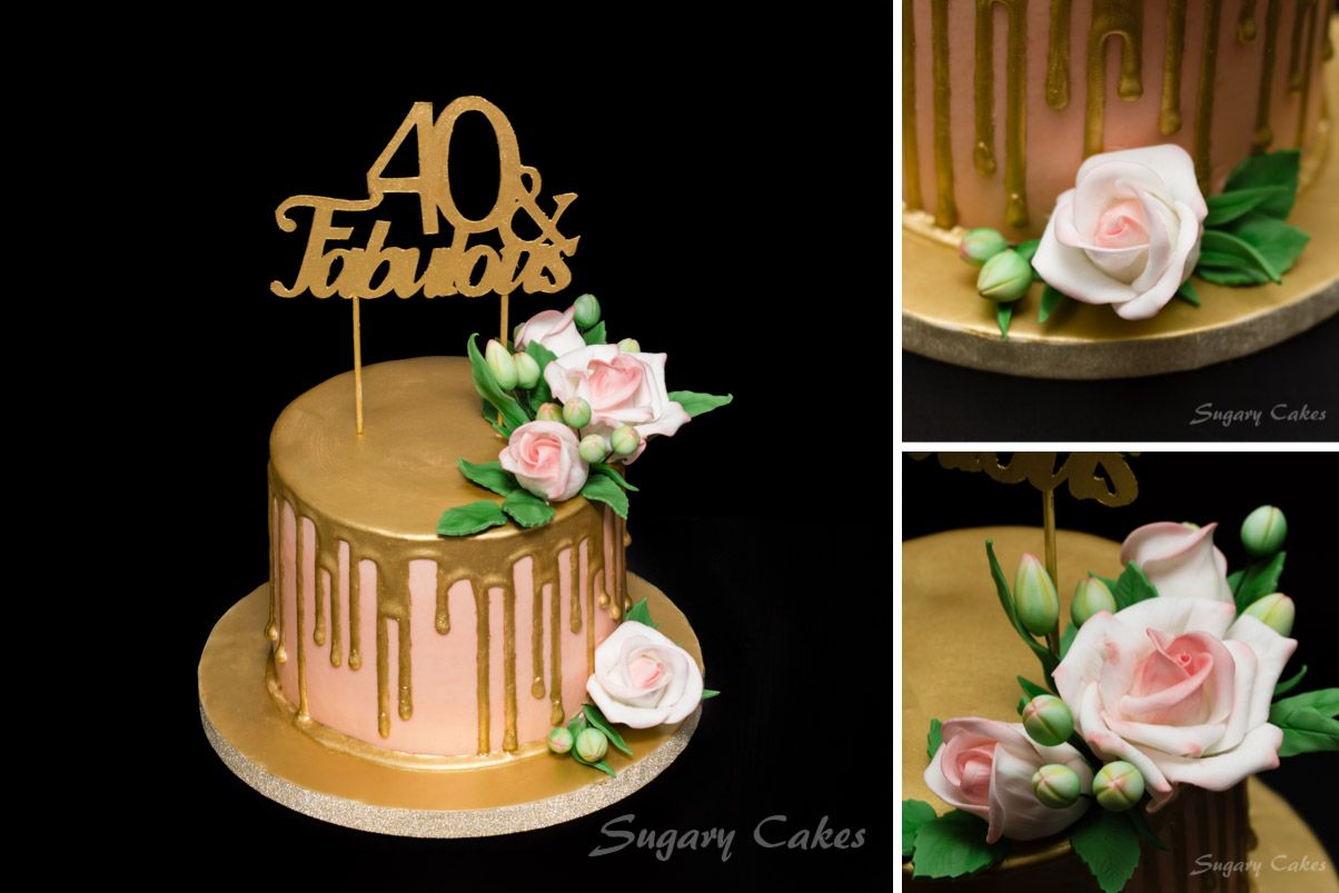 A gold drip cake with handmade roses.