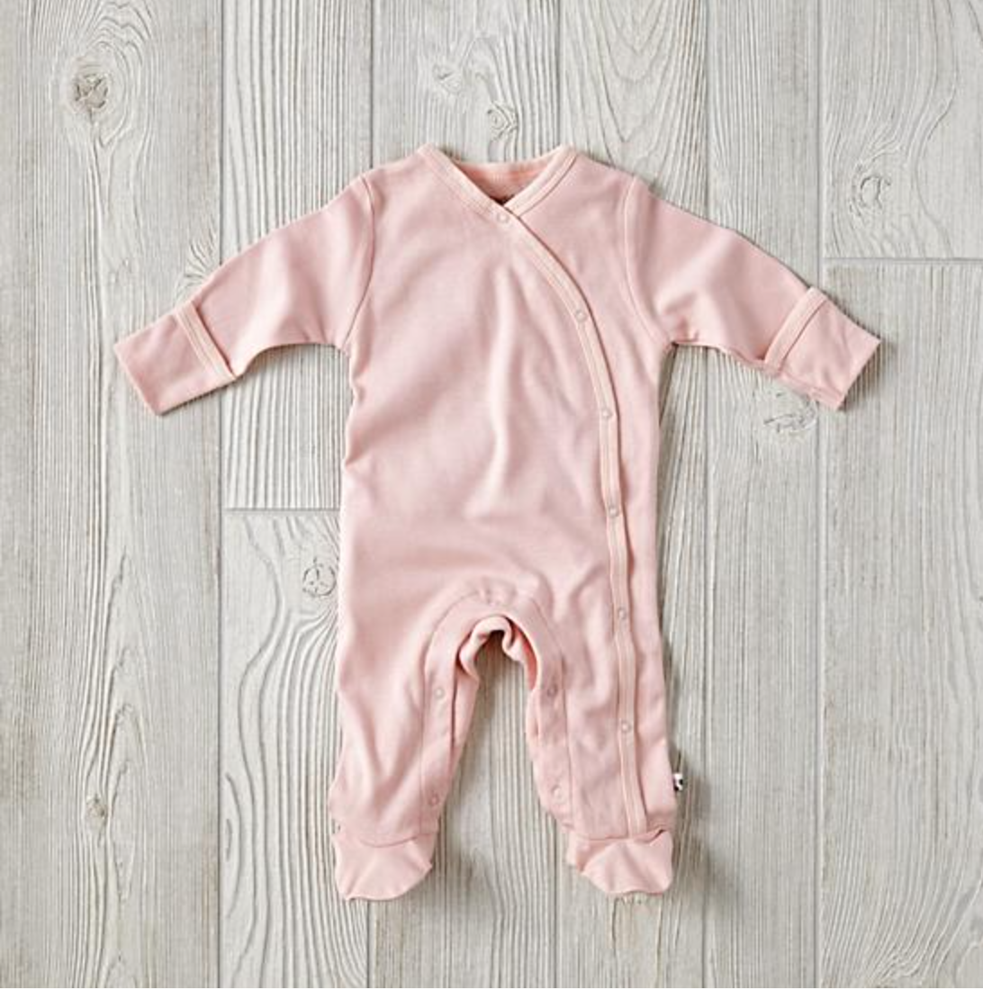 1d860a97fd These soft and cuddly footie pajamas from Babysoy are made from a blend of organic  cotton and Azlon