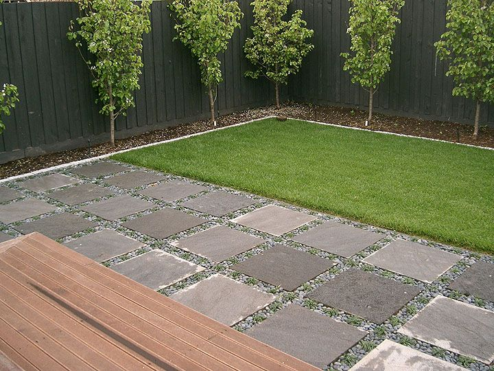 good for side yard large paver patio green area and trees along fence