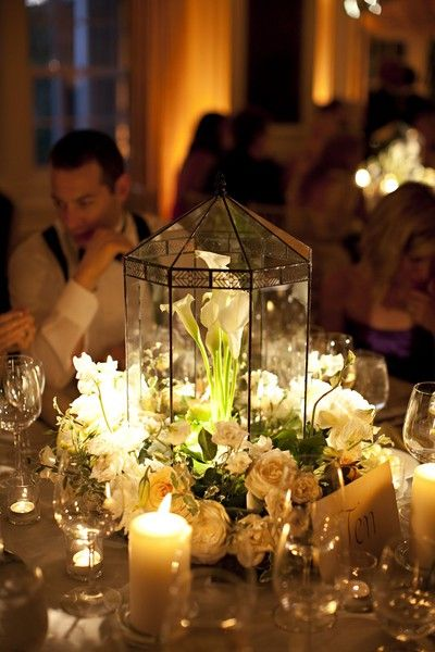 Beautiful centerpieces on this site for the secret garden themed wedding!