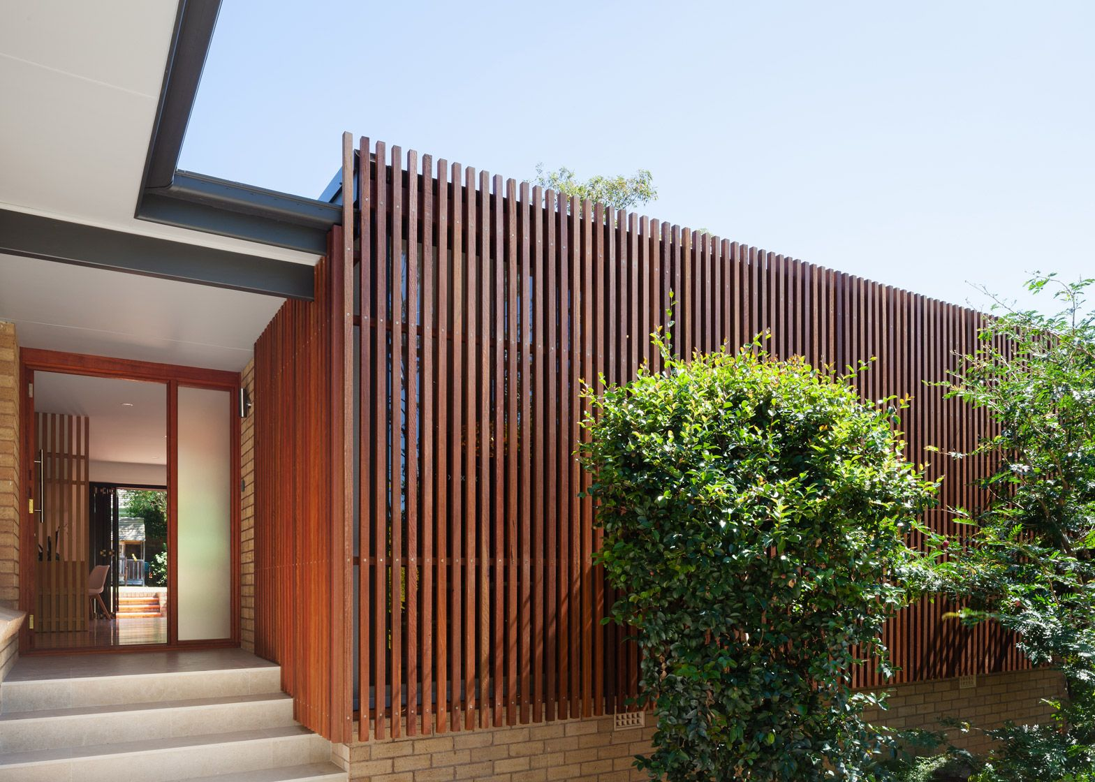 A Slatted Wooden Screen Wraps Around The Extended Living