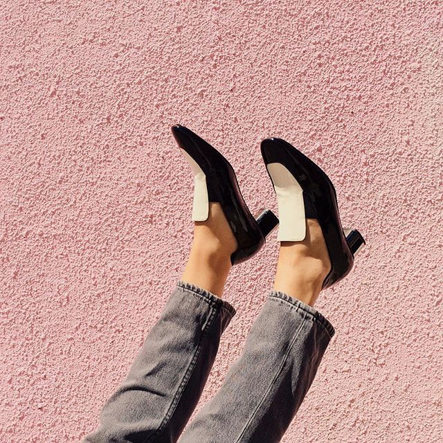 @robertclergerie new arrivals looking fresh against a pink wall. #kickpleat #austinfashion #style #colorinspiration