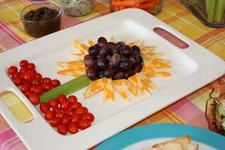Flower cheese tray - use crackers instead of tomatoes for a cheese and cracker tray