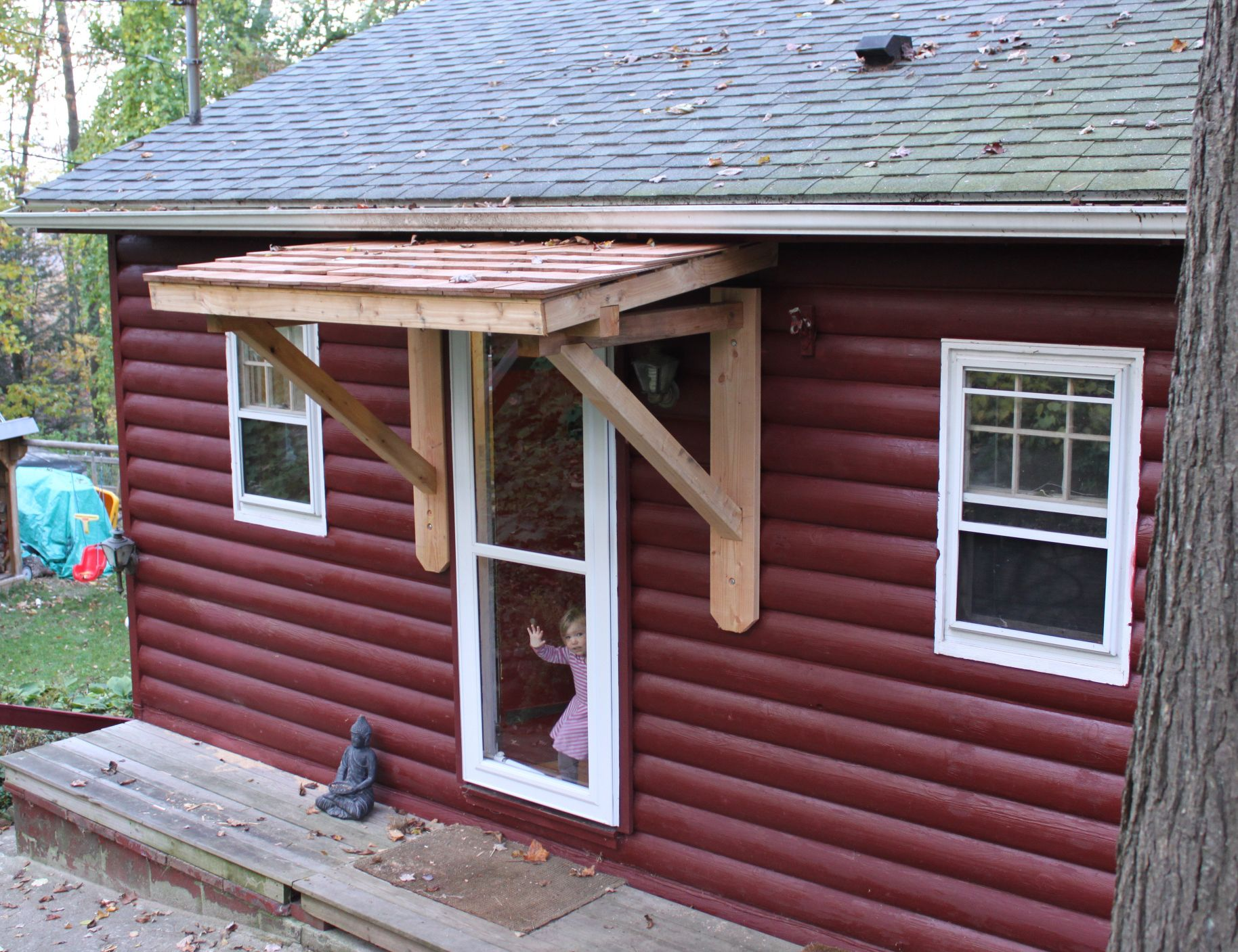 Weekndr project front door cedar awning roof overhang for Front door roof designs