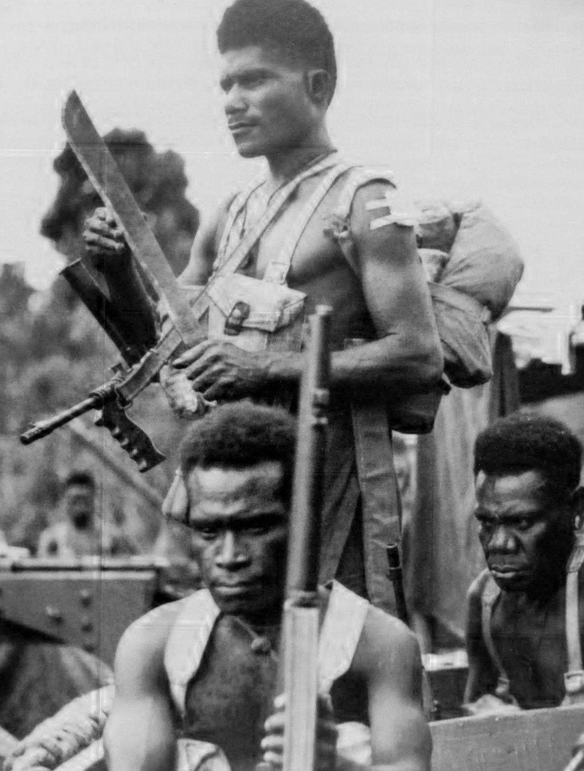 Troops from the 1st New Guinea...