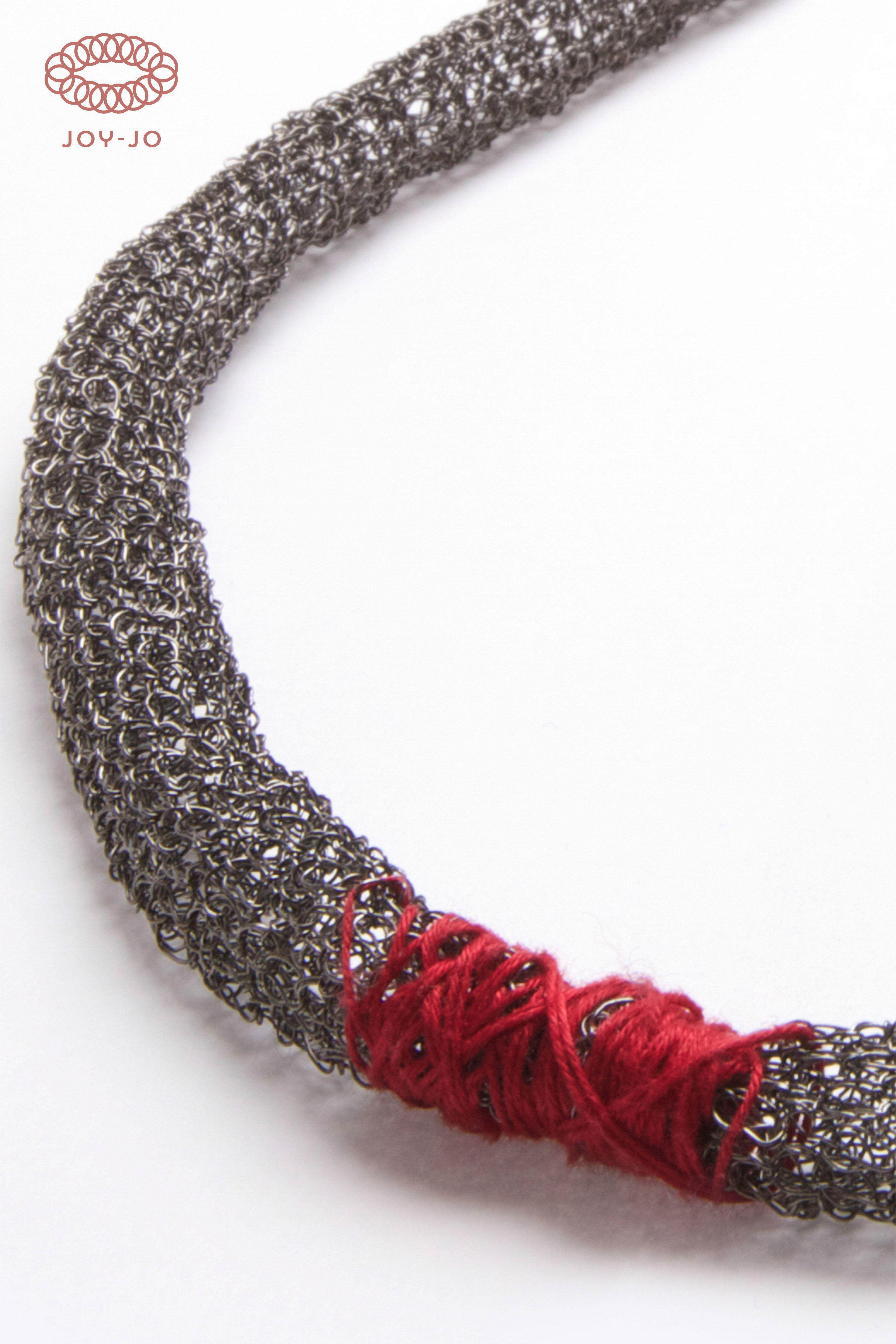 Symbiosis-Red Pepper: made of copper dipped in black rhodium with cotton insert