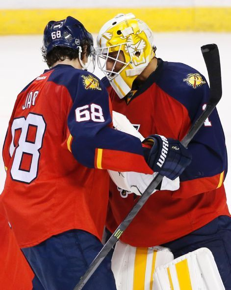 Florida Panthers right wing Jaromir Jagr (68) and goalie Roberto Luongo  congratulate each other after the Panthers defeated the Buffalo Sabres 3-2  in an NHL ... e013357f0