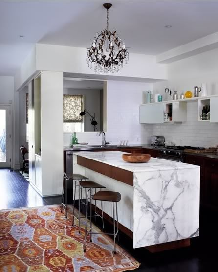 adore the marble island with chairs enough for 4-6.  6 preferably. this kitchen is too small but love the marble.