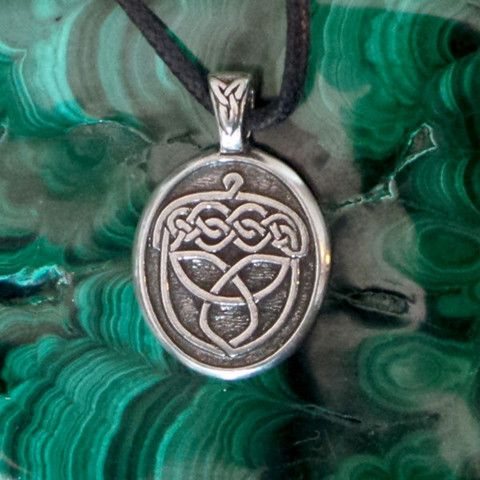 This fine pewter pendant is striking to look at and comfortable to wear. The design is raised with an antiqued background. It comes on an adjustable black waxed cotton cord, and it would also look gre