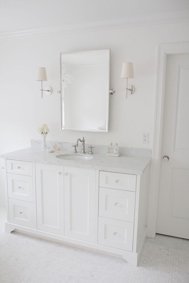 Wall and cabinet paint color is Benjamin Moore Simply White OC-117