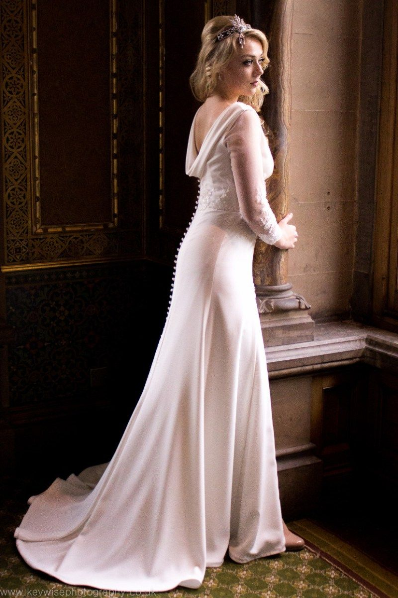 Chloe- Stunning pure silk crepe gown with long beaded lace sleeves and cowl back detail.