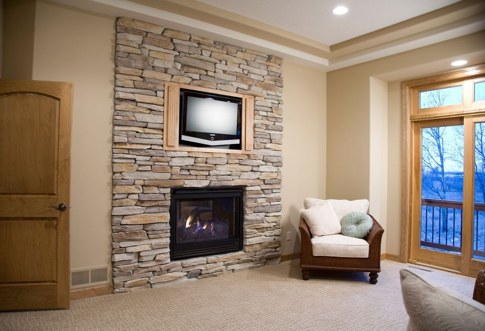 Faux Stone Fireplace with Chair
