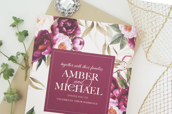 Garden themed wedding never looked so good with this watercolor burgundy floral wedding invitation suite by Posh Paper.