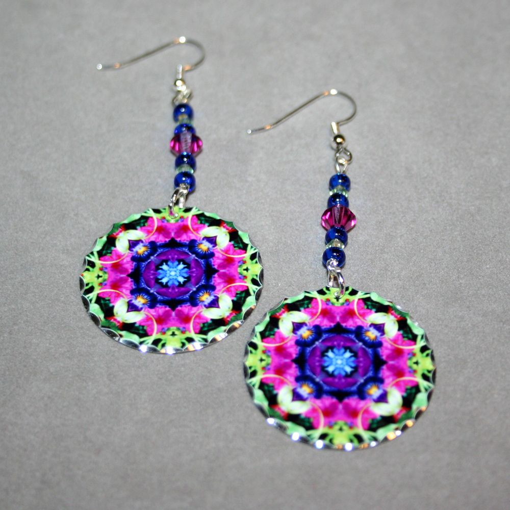 Silver dangle earrings with a Petunia mandala sacred geometry charm titled Serendipity. <br /> <br />These lightweight, dainty silver earrings begin with a dangle of Sapphire and light green Czech glass beads and pink Swarovski crystal that accentuate the colors in the mandala charm that has scalloped edges that catch the light. The mandala charm is 1 – �...