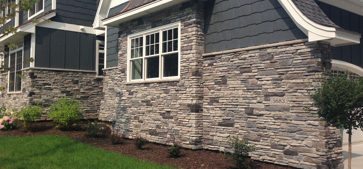Home exterior blend echo ridge black rundle Stone products for home exterior
