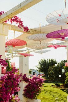 Pink parasols & a garden arbour.  So pretty!