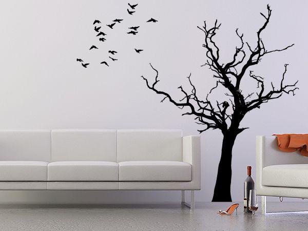 schlicht aber wirkungsvoll zeichnet sich dieser baum von der wand ab die v gel k nnen sie frei. Black Bedroom Furniture Sets. Home Design Ideas