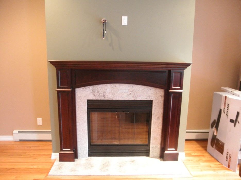 Furniture. White Marble Feat Dark Brown Fireplace Mantle Surround ...