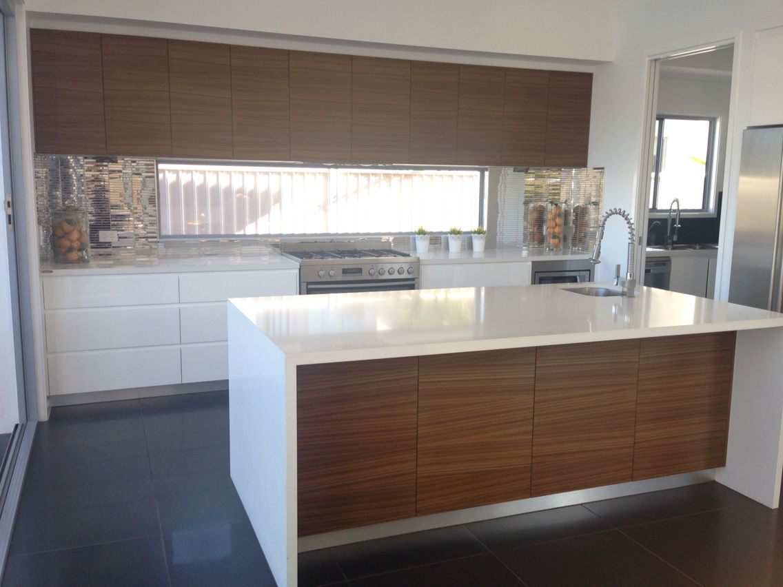 Dark Timber Accent Island Bench And Cupboards In Kitchen