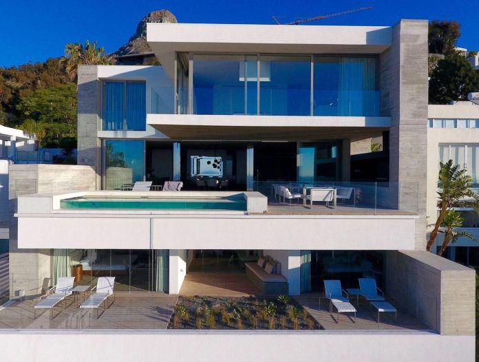 Three14architects Design Ovd525 A Minimalist Home Located On A Steep Mountainside Site In Bantry Bay Cape Town Contemporary House Design House House Design