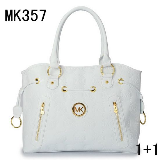 569ca1ec0f05 Rhea backpack by MICHAEL Michael Kors. A structured MICHAEL Michael Kors  backpack in pebbled leather. Polished logo lettering accents th.