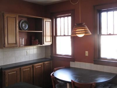 Kitchen before--not the cardboard, yes, cardboard, light ...
