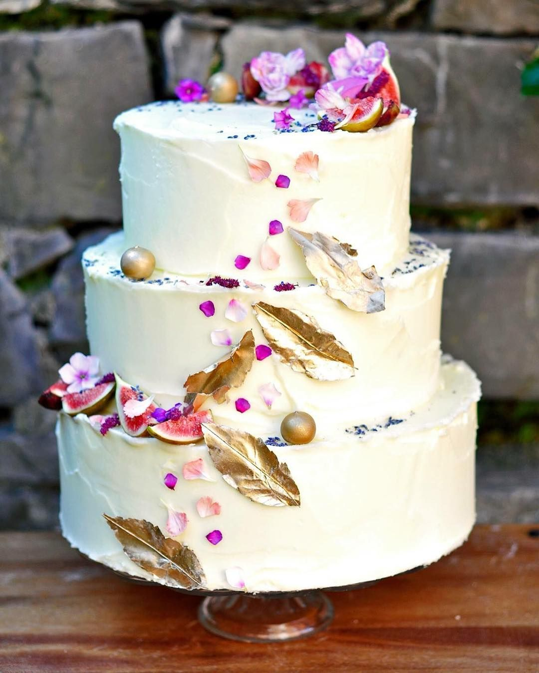 Spring inspired wedding cake with edible flower petals u gold
