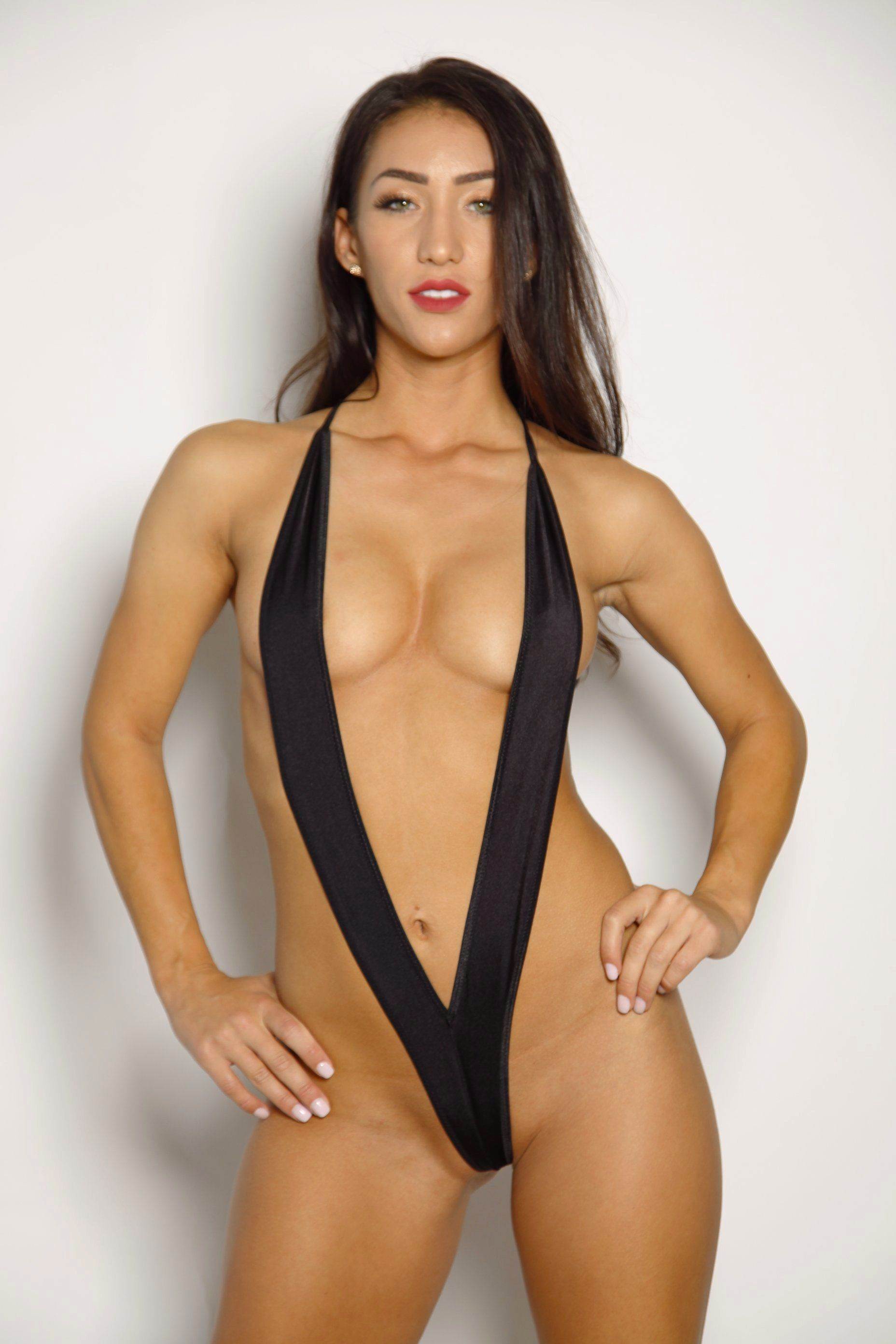a1484e2612 Sexy Model in Bitsy's Bikinis Solid Black Slingshot Bikini String Extreme  Unlined Shop Slings Online