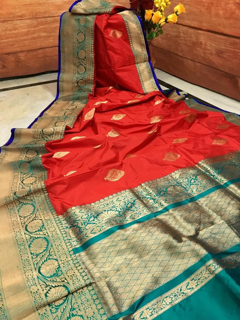 3f38c6e13b1b45 Bright Red color pure Katan Banarasi silk saree in Teal Green combination  keeps the traditional Banarasi essence within a fashionable wrap. All over  body ...