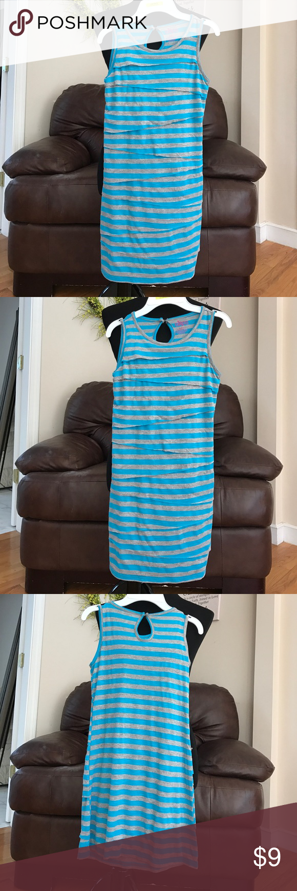 Girls asymmetrical stripe summer dress NWOT Cute jersey dress with grey/blue stripe asymmetric from and keyhole back with button. Nice for spring. No tags, never worn Circo Dresses Casual