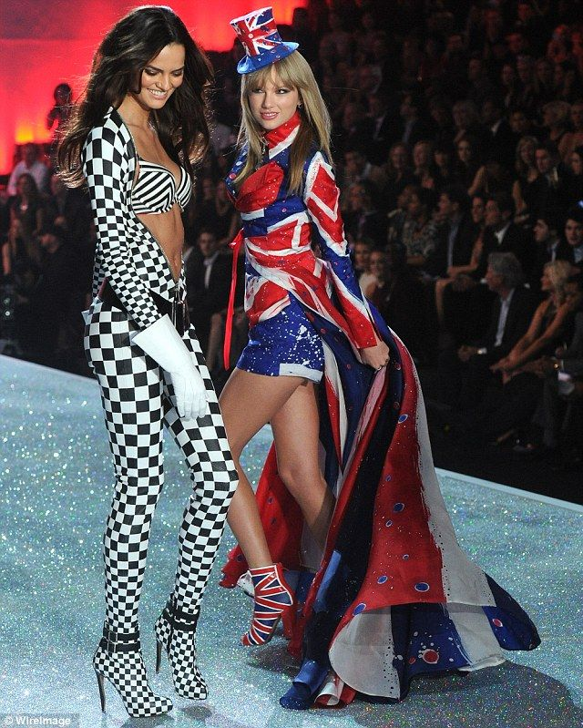 Watch the cape: Barbara Fialho made sure she didn't step on Taylor's cap on the runway
