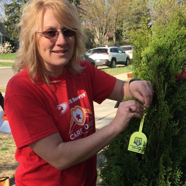 Dte Care Force Volunteer Showing Off New Miss Dig Tree Tags Empowerment Care Tree Tags Women for trump coalition advisory board member. pinterest
